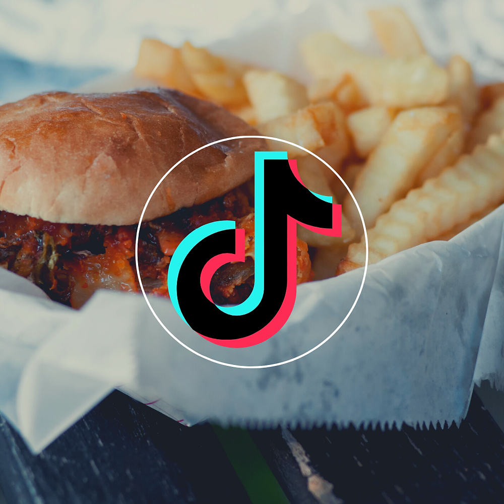 A plate with a burger and fries with the TikTok logo in front
