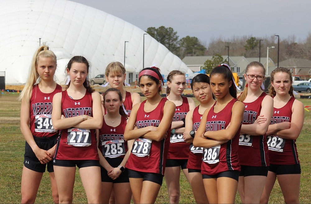 The Meredith Cross Country Team standing together