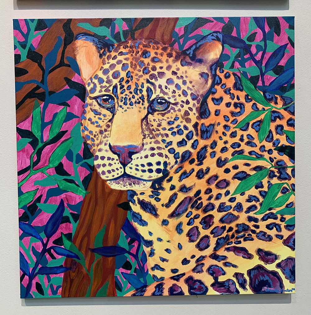 A jaguar with a brightly colored forest in the background