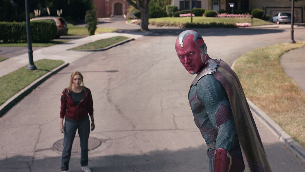 Wanda and Vision standing on a street