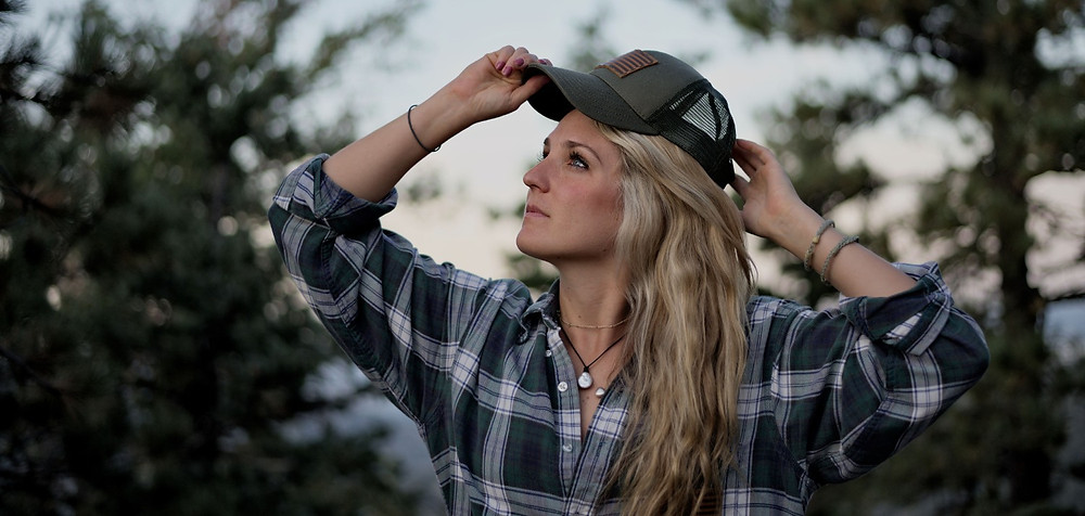 Personal brand photographer outdoor photo shoot hat