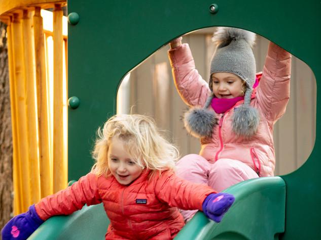 Two little girls on slide, Beacon Hill Nursery School