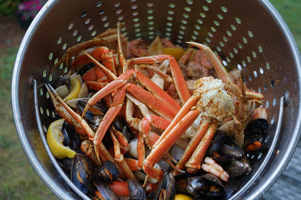 DelMarVa Boil Company snow crab legs in a Signature Seafood Boil