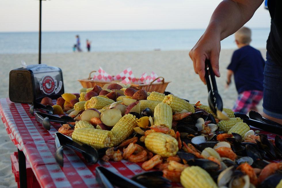 DelMarVa Boil Company Signature Seafood Boil on the beach