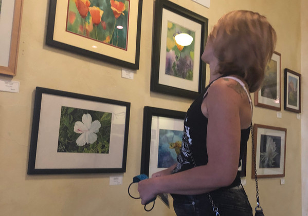 Lacey Epperson viewing the artist display