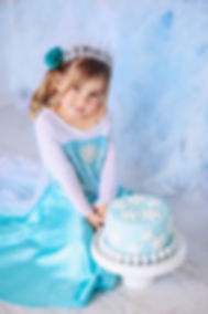 Little princess girl on a styled Frozen