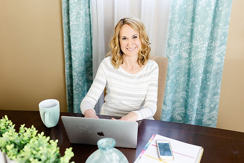 Professional home organizer Amy Traugh sitting and smiling