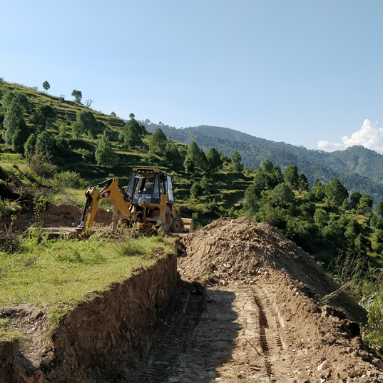 Levelling land for construction.