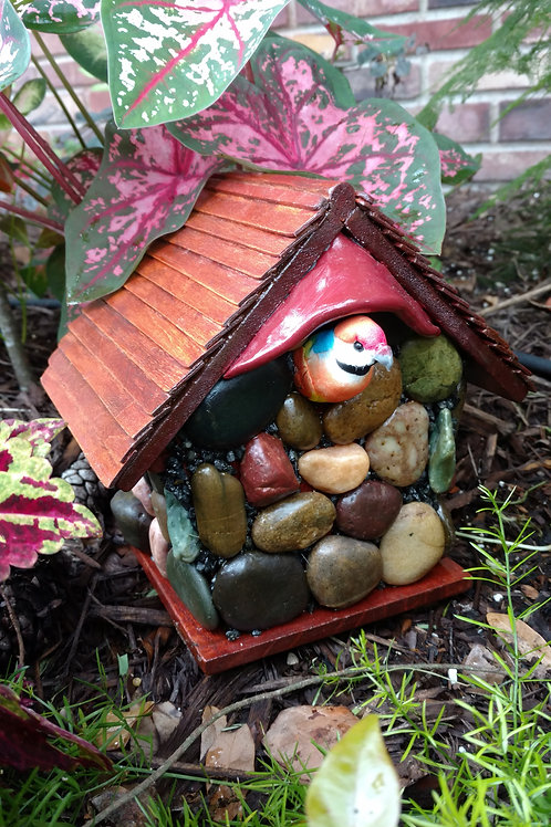 River Stone bird house with wooden roof