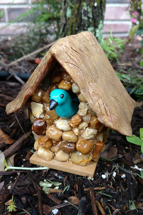 Bird House with a 'thacthed clay' roof