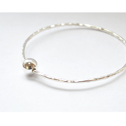 Beaten Bangle with Moving Bead