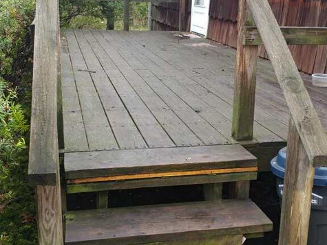Homeowner needed front deck redone and also wanted to add handicap access for her mother. Mastic 1 of 2