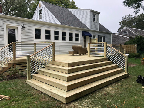 500 square ft deck with pressure treated decking and custom metal railings. Bellport Village. 1 of 6