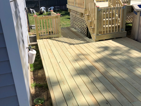 680 sq ft multi level deck with pressure treated decking and railing. Mastic. 1of 8
