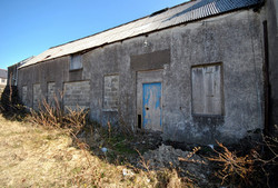 Boarded up windows and doors