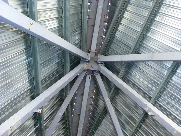 Solar House interior steel connection hub