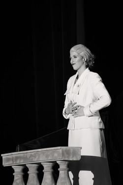 Eva addressing crowd