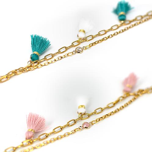 Braccialetti moda in acciaio anallergico gold con  nappine colorate in stile ibiza