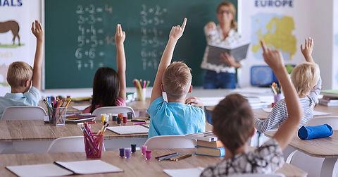 teacher-hands-raised-min.jpg
