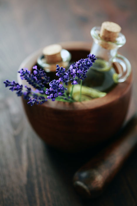 lavender massage oil with mortar and pes