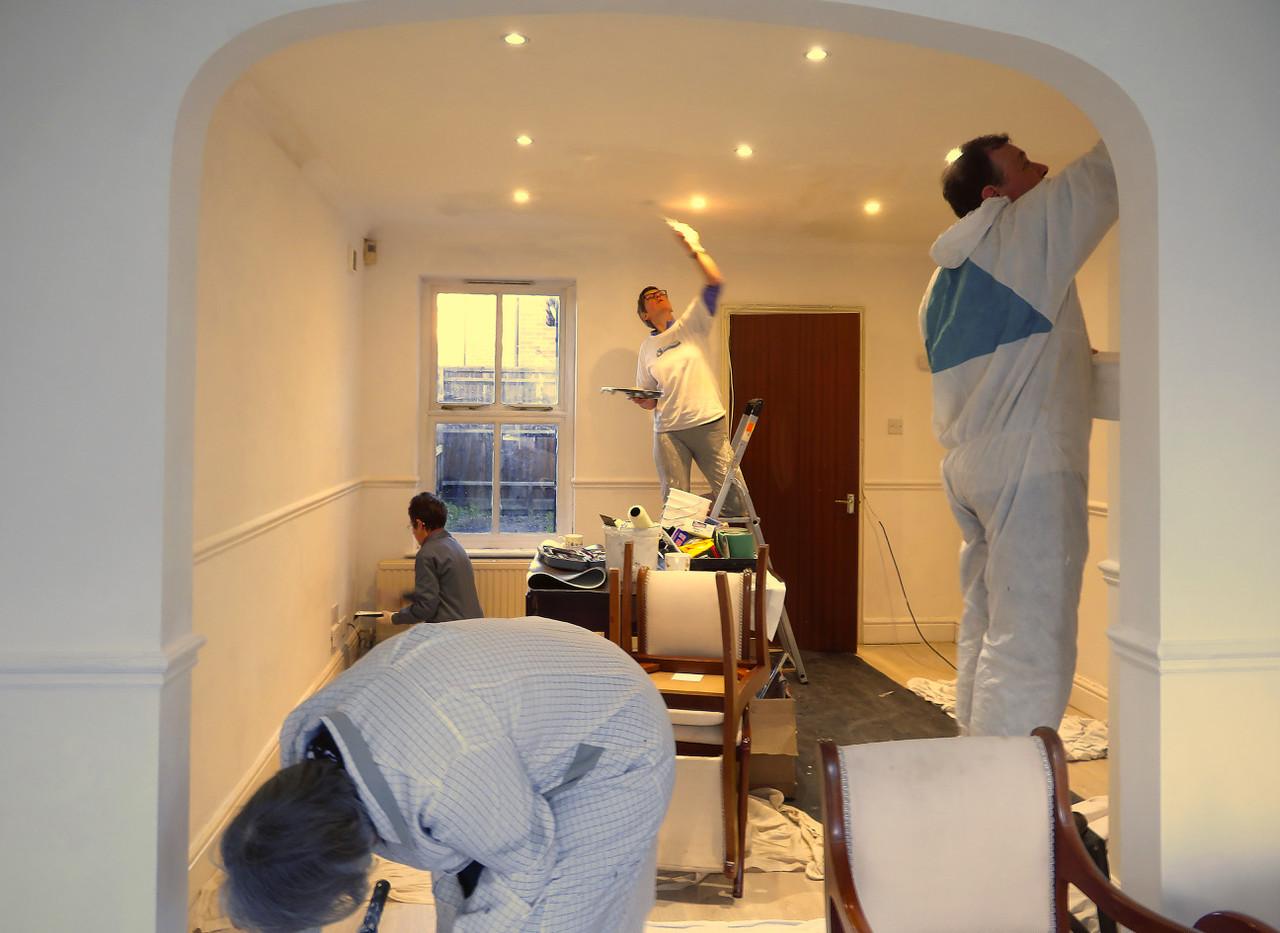 Volunteers painting Mellor House