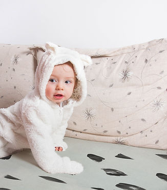 Baby on a Bed