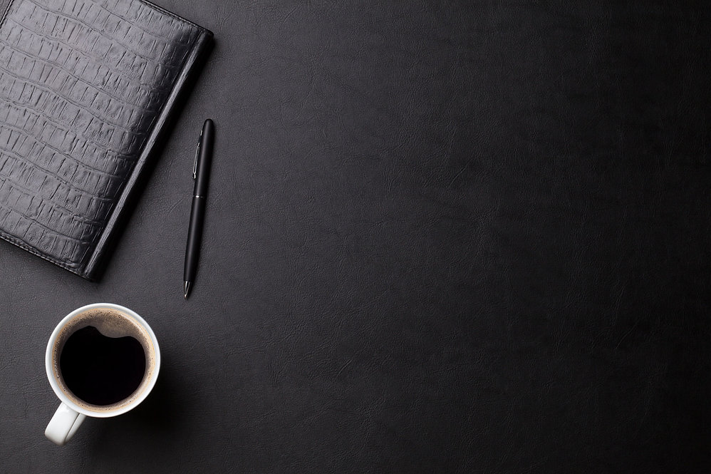 Notebook and coffee cup background