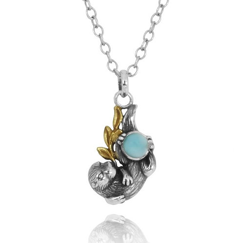 [NP12864-LAR] Oxidized Silver Otter With Gold Holding Round Larimar Pendant