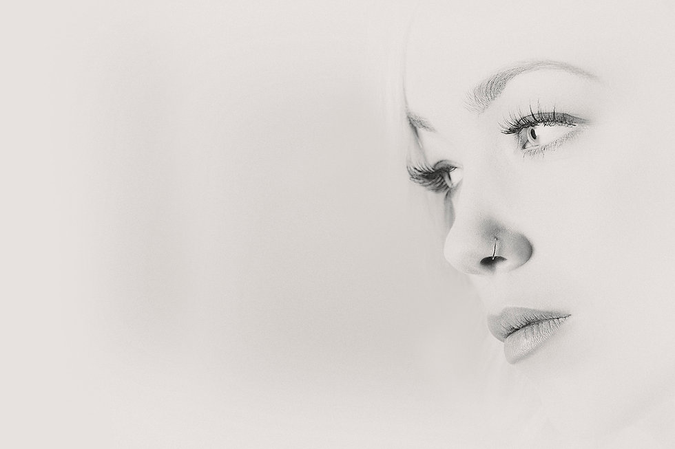 High key sensual black and white advertising image of a girl's face