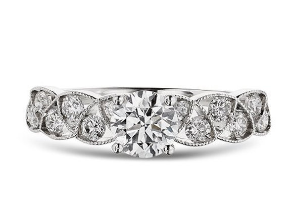 Round Cut Diamond Ring with Cross Over Design