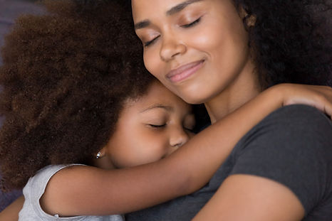Loving single black mother hugs cute dau
