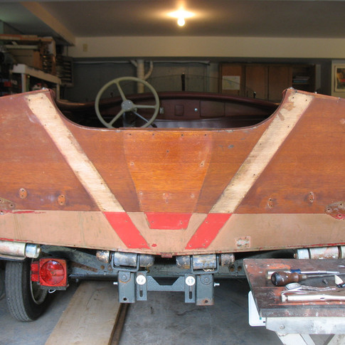 Hardware, braces, and motor plate removed, showing red bottom paint from the factory!