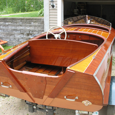 This shows our work on the transom and back of the seat nicely. We also painted the deck seams.