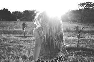 Girl Running in a Field_edited.jpg