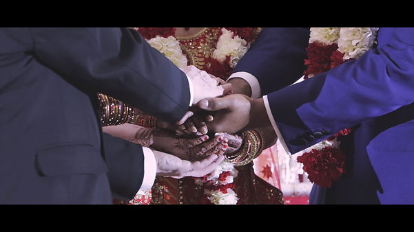 Hands united symbolize the couple's union on their special day.