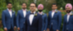 The groom and groomsmen pose for a picture at the Royal Ambassador.