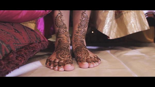 Beautiful henna tattoo (mehndi art) done at the brides foot.