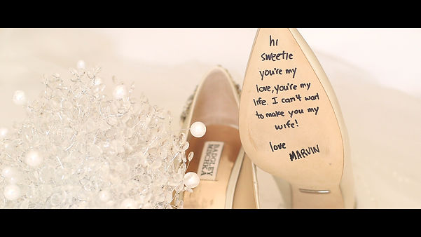 A shot of the bride's shoe and a lovely message from the groom.