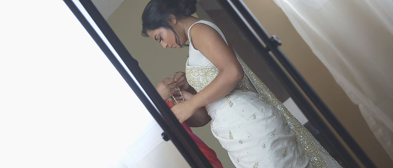 Sabina getting her saree put on, during her getting ready.