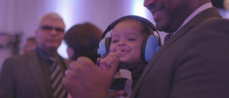 Little boy dancing with headphones on
