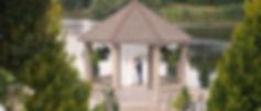 The couple at the Lakeside gazebo located at Royal Ambassador.