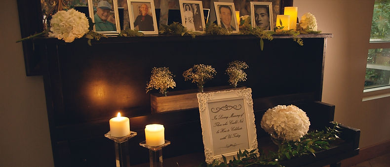 An altar pays tribute to the couple's missed ones.