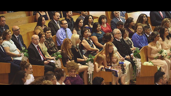 The church is full of guests present at the couple's ceremony.