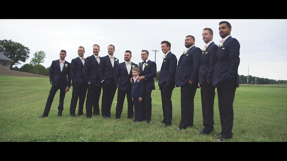 Groomsmen posing for picture