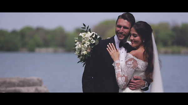 The couple hold each other by the lake in Mississauga, at the Adamson Estates.