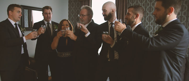The groomsmen making a toast to the groom.