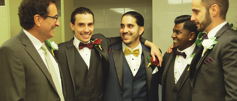 Peter looks happy while getting ready with his fellow groomsmen.