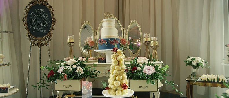 The beautiful cake and dessert table at reception held at the Greenhouse room inside the Royal Ambassador.