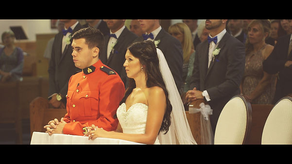 The couple listening attentively to the priest at their wedding ceremony.