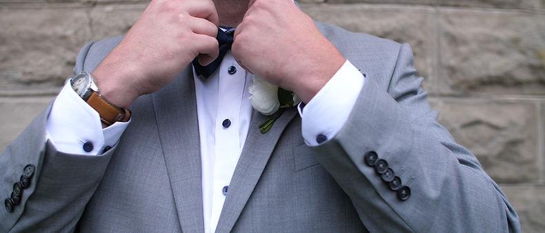 The groom getting dressed